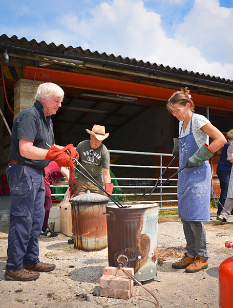 Carol and Richard remove pots from the kiln