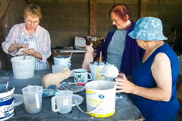 BPPS members busy glazing prior to firing