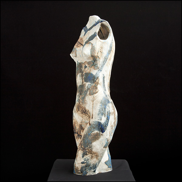 Stoneware torso for indoors or garden. Leaf imprints and glossy and matt glazes. Approx 60cm high.