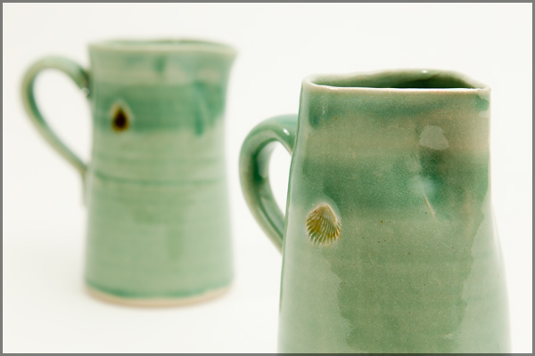 Green jug with shell motif - approx. 15cm in height