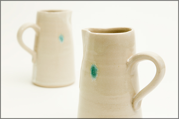 Cream jug with shell motif - approx 15cm in height