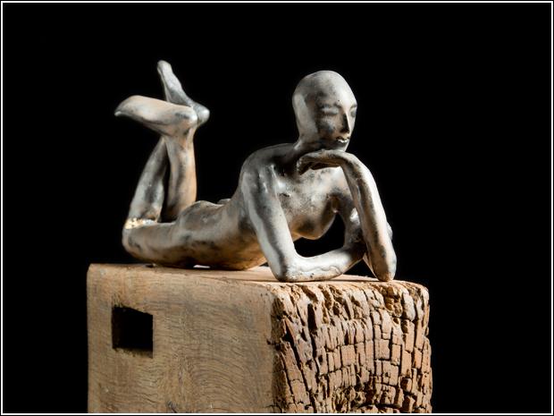 Ceramic figure with gold leaf details